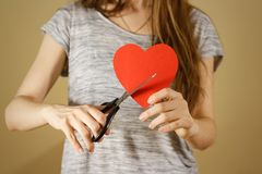 Female hand holding red Valentines card with heart on  b Royalty Free Stock Photography