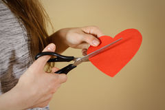 Female hand holding red Valentines card with heart on  b Royalty Free Stock Photos