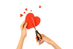 Female hand holding red Valentines card with heart on a white ba. Ckground. Ð¡ut with scissors stock image