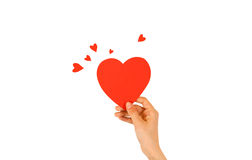 Female hand holding red Valentines card with heart on a white ba. Ckground royalty free stock photo