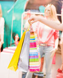 Female hand holding shopping bags Royalty Free Stock Images