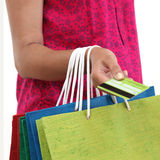 Female hand holding shopping bags and credit card Stock Photos