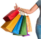 Female hand holding shopping bags and showing ok Stock Photos