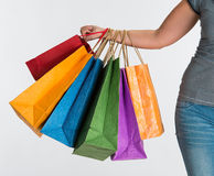 Female hand holding shopping bags Royalty Free Stock Photos