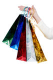 Female hand holding shopping bags Stock Photo