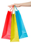 Female hand holding shopping paper bags Stock Photos