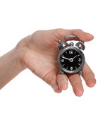 Female hand holding a small alarm clock Stock Photography