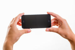 Female hand holding a smart phone Royalty Free Stock Photography