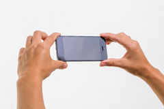 Female hand holding a smart phone Royalty Free Stock Photos
