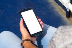 Female Hand Holding Smart Phone Stock Photography