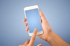 Female hand holding smartphone Stock Photos