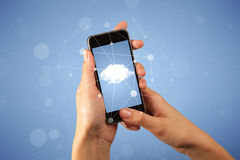 Female hand holding smartphone. Female fingers touching smartphone with cloud concept Stock Image