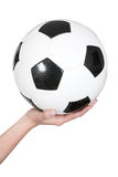 Female hand holding a soccer ball Stock Images