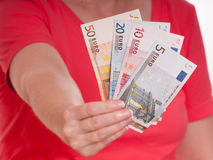 Female hand is holding some euro notes Royalty Free Stock Photos