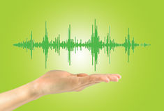 Female hand holding a sound wave Stock Images