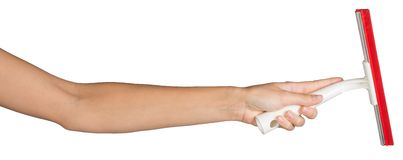 Female hand holding squeegee Royalty Free Stock Images