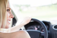Female hand holding steering wheel Stock Photos