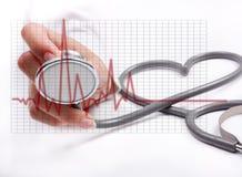 Female hand holding stethoscope Stock Photo