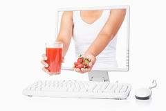 Female hand holding strawberry and juice Royalty Free Stock Photography