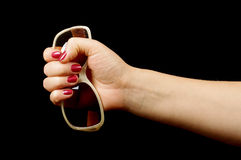 Female hand holding sun glasses Royalty Free Stock Photography