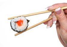 Female hand holding sushi Royalty Free Stock Photos