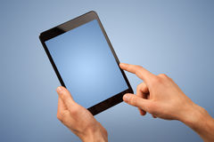 Female hand holding tablet Royalty Free Stock Photography