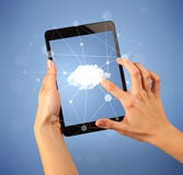 Female hand holding tablet. Female fingers touching tablet with cloud concept Stock Photo