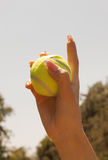 Female hand holding tennis ball. Close up of female hand holding tennis ball stock photos