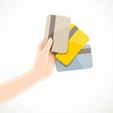 Female hand holding three credit cards gold, platinum and normal Stock Photo