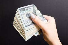 Free Female Hand Holding Tightly A Bundle Of Money. Top View Of One Hundred And Different Dollars On Colorful Background. Investment Royalty Free Stock Photography - 159314557