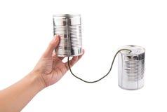 Female Hand Holding Tin Can Telephone I. Female hand holding tin can telephone over white background Stock Photos