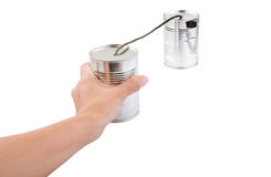 Female Hand Holding Tin Can Telephone II. Female hand holding tin can telephone over white background Royalty Free Stock Image
