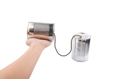 Female Hand Holding Tin Can Telephone IV Stock Image