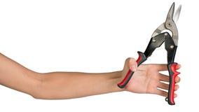 Female hand holding tin snips Stock Photo