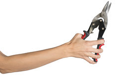 Female hand holding tin snips Stock Images