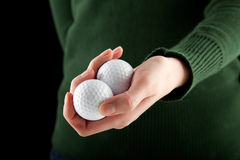 Female hand holding two golf balls Royalty Free Stock Photography