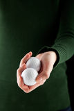 Female hand holding two golf balls Stock Photos