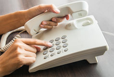 Female hand holding up the phone Royalty Free Stock Photo