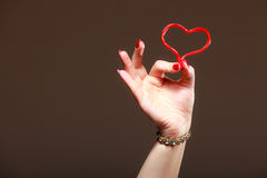 Female hand holding valentine red heart love. Valentines day. Stock Photography