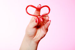 Female hand holding valentine red heart love. Valentines day. Stock Images
