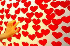 Female hand holding a Valentines Day card with scattered cut paper hearts. Female hand holding a Valentines Day card with scattered cut paper hearts on plastic stock photography