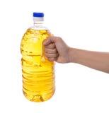 Female Hand Holding Vegetable Oil I Stock Photos