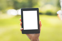 Female hand holding white tablet Royalty Free Stock Images