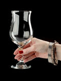 Female hand holding wine glass Stock Images