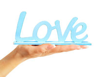 Female hand holding Wooden signboard love Stock Images