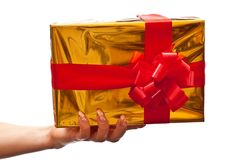 Female hand holding yellow gift box Royalty Free Stock Images