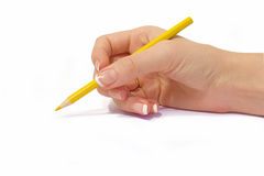 Female hand holding yellow pencil Stock Photography