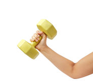 Female hand holding yellow plastic coated dumbell isolated on wh Royalty Free Stock Images