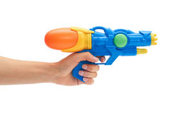 Female hand holds blue squirt gun. Isolated on white background.  stock photos