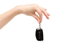 Female hand holds car keys. Female hand holds car keys on white background Royalty Free Stock Photo